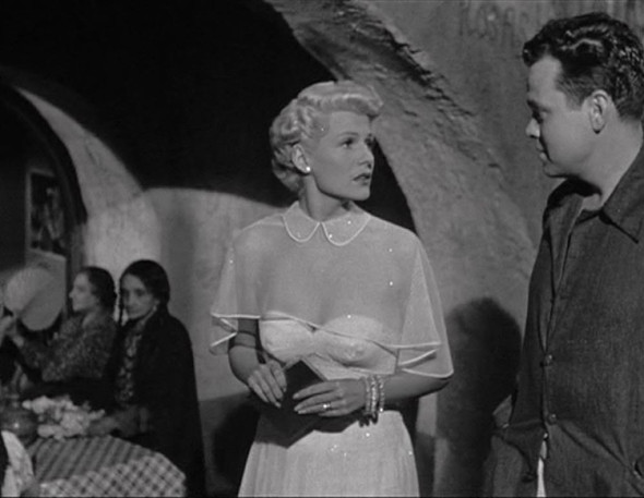 The femme fatale is wearing white-Rita Hayworth in The Lady from Shanghai