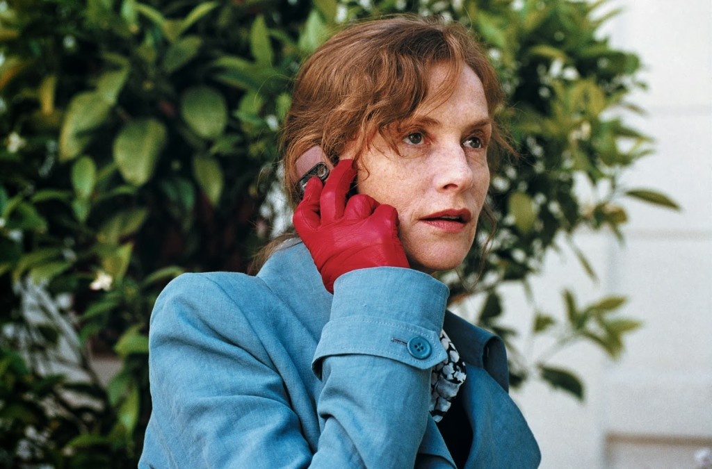 Isabelle Huppert in A Comedy of Power - the red gloves