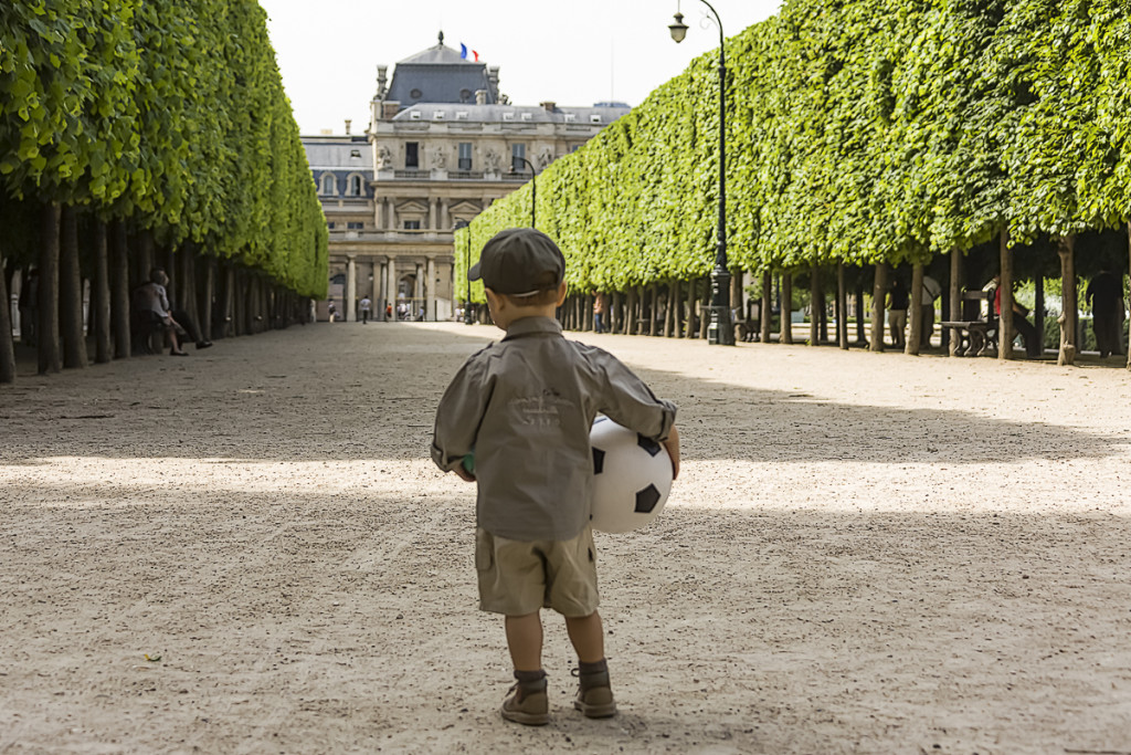 Young aspiring footballer, Palais Royal gardens, Paris, France